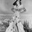 Woman posing in striped and polkadot costume — Stock Photo #12301968
