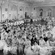 Large group of gathered in hall - Stock Photo