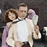 Woman helping man tie bow tie — Stock Photo
