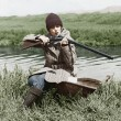 Female hunter with gun near river - Foto de Stock