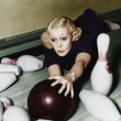 Stock Photo: Woman having bowling accident