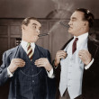Photo: Two men smoking cigars