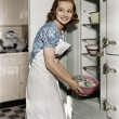 Portrait of woman in kitchen — Foto Stock