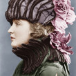 Stock Photo: Womwearing elaborate hat