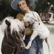 Woman with goat and pony — Stock Photo #12302713