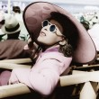 Stock Photo: Womin big sun hat and sun glasses