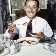 Young man having breakfast and smiling — Stock Photo #12302831
