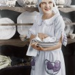 Stock Photo: Housekeeper drying plates