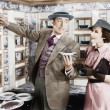 Man serving a dish to a woman in a Automat — Stockfoto