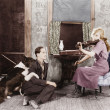 Woman playing the violin for her boyfriend and dog — Stock fotografie
