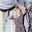 Woman hanging a valance — Stockfoto