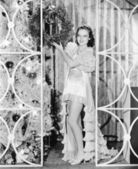 Woman in lingerie holding a Christmas wreath — ストック写真