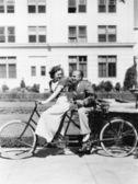 Couple riding tandem bike — Stock Photo