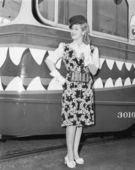 Female conductor standing in front of a tour trolley — Stock Photo