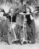Two women standing on their scooters — Stock Photo