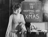 Woman with sign with number of shopping days until Christmas — Stock Photo