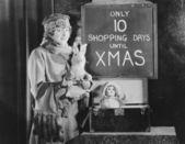 тревожно женщина и знак с количество торговых дней до рождества — Стоковое фото
