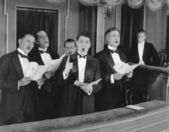 Men singing in choir — Stock Photo