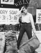 Worried man holding sack — Stock Photo