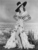 Woman posing in striped and polkadot costume — Stock Photo