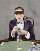Portrait of gambler at card table — Stock Photo
