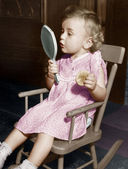 Little girl looking in mirror — Stock Photo