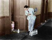 Milkman greeting baby at door — Stock Photo