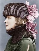 Woman wearing elaborate hat — Stock Photo