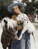 Woman with goat and pony — Stock Photo