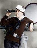 Portrait of sailor looking through binoculars — Stock Photo
