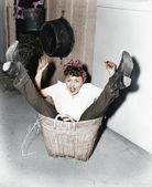 Woman falling into basket — Stock Photo