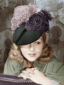 Portrait of a woman with a feathered hat — Stock Photo