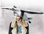 Portrait of a young woman wearing an airplane shaped cap — Stock Photo