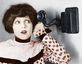 Portrait of a young woman talking on the telephone — Stock Photo