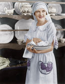 Housekeeper drying plates — Stock Photo