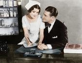 Nurse sitting on the doctor's lap — Stock Photo