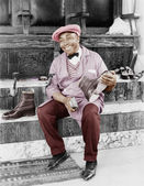 Shoeshine man working and smiling — Stock Photo