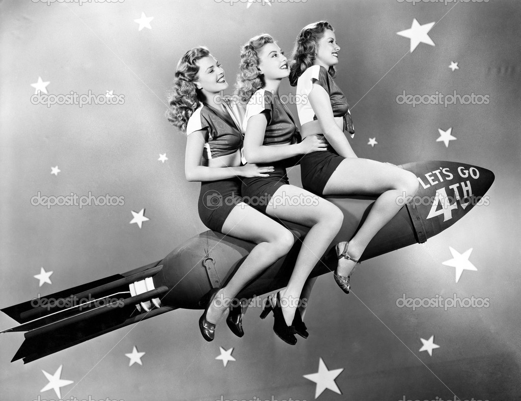 Three women sitting on a rocket — Stock Photo #12300923