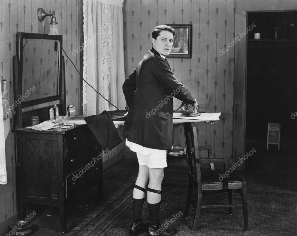 Man in sock garters ironing — Stock Photo #12301675