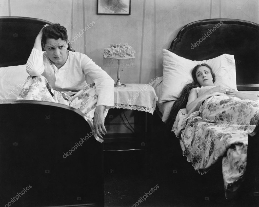 Young couple in separate beds after fight — Stock Photo #12301744
