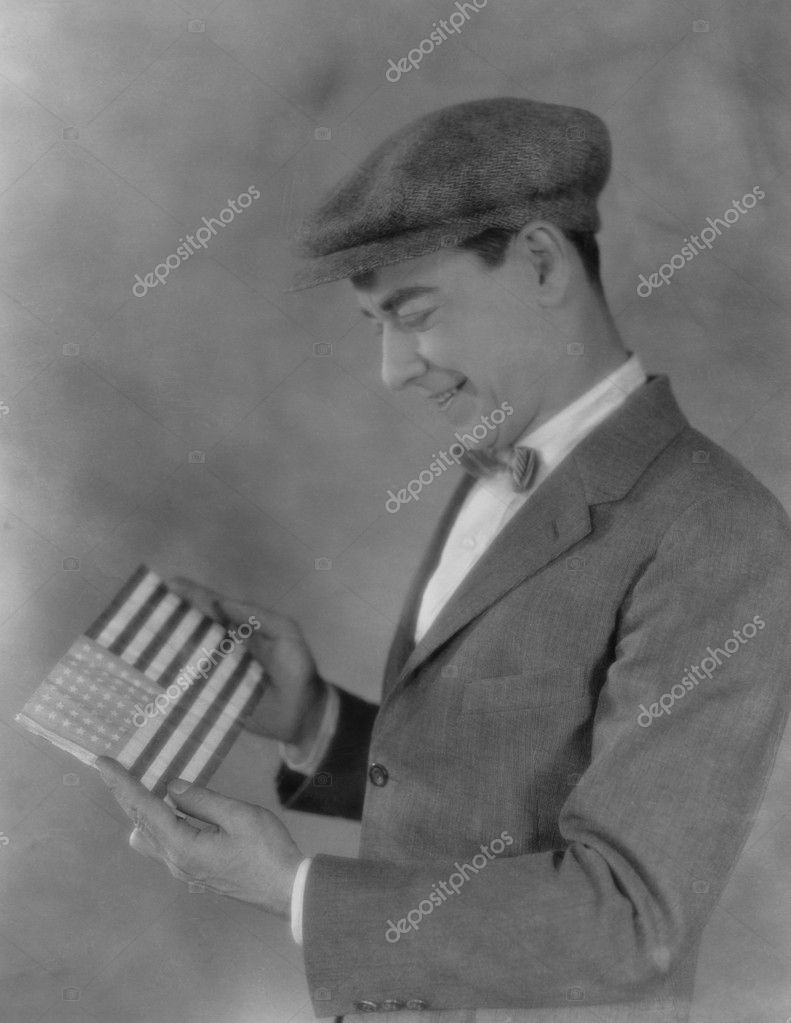 Smiling man looking at flag — Stock Photo #12301795