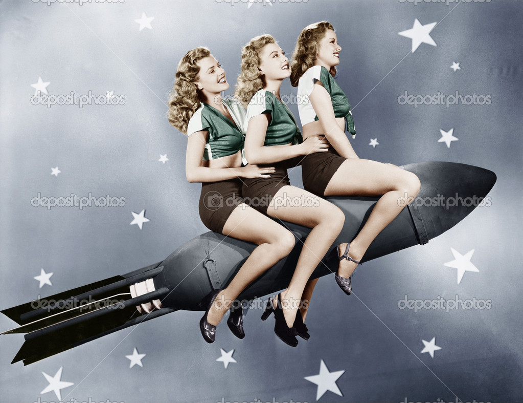 Three women sitting on a rocket — Stock Photo #12302956