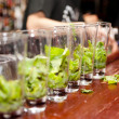 Highball glasses with mint - preparing mojitas — Stock Photo