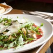 Italian carpaccio on restaurant table — Stock Photo
