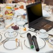 Stock Photo: Laptop and microphones on restaurant table