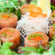 Sushi of daikon, carrot and salmon — Stock Photo