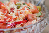 Mediterranean salad in glass plate, selective focus — Stock Photo