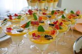 Fresh and tasty fruit dessert prepared for banquet — Stock Photo