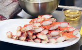 Raw crab legs, oil and meat on commercial citchen — Stock Photo