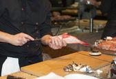 Chef prepares fish for grill — Stock Photo